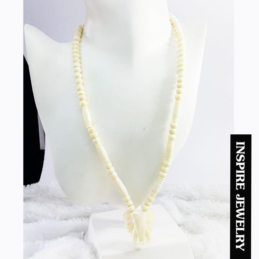 inspire jewelry สร้อยคอทำจากกระดูกช้างมีจุดห้อยพระได้ 1 องค์ ร้อยกับสเตนเลส ห้อยพระที่หัวช้างร้อยกับสแตนเลส และตัวสร้อยทำลายสวยงาม งานhandmade ให้โชคลาภเสริมอำนาจวาสนา ป้องกันสิ่งอัปมงคล