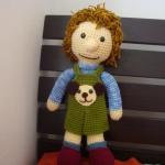 ตุ๊กตาถักโครเชต์ใส่เอี้ยมสีเขียว